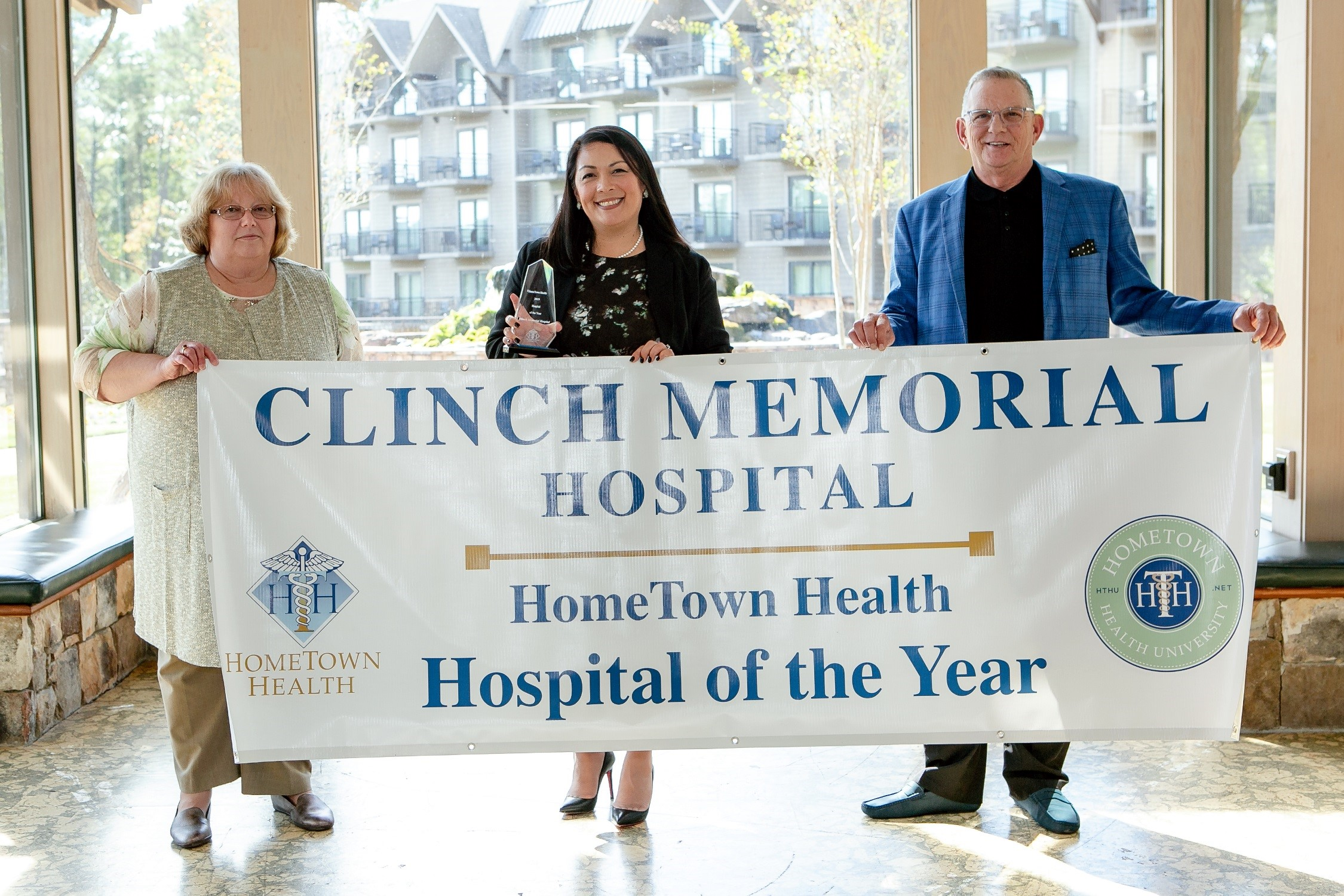 Clinch Memorial Hospital executives receiving HomeTown Health Hospital of the Year Award.  From left: Teressia Shook, CFO; Angela Ammons, CEO; Preston King, Compliance Officer.